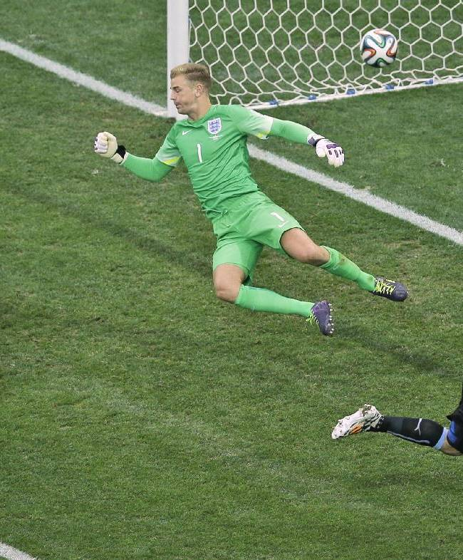 Uruguay's Luis Suarez, right, celebrates scoring the opening goal past England's Phil Jagielka, left, and goalkeeper Joe Hart during the group D World Cup soccer match between Uruguay and England at the Itaquerao Stadium in Sao Paulo, Brazil, Thursday, June 19, 2014