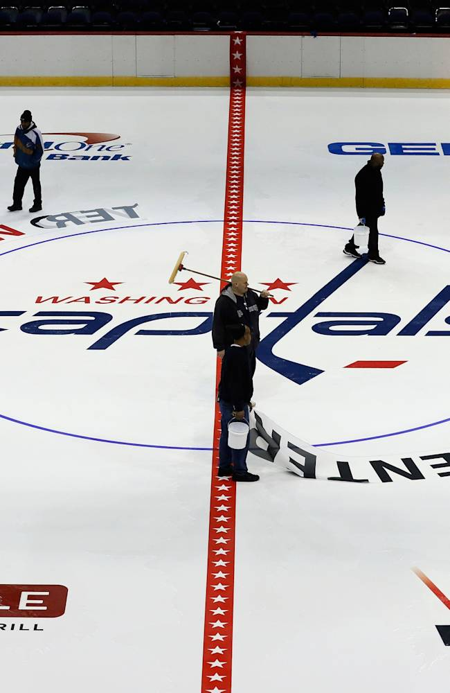 Washington Capitals Install Logo And Lines In Verizon Center Ice