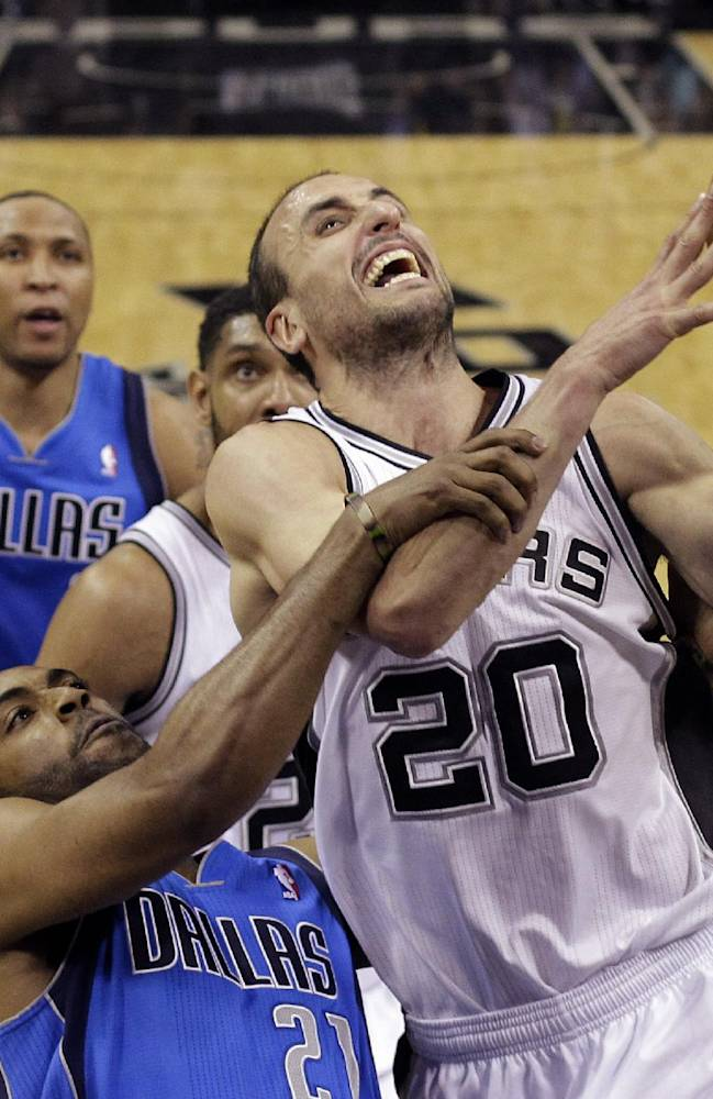 San Antonio Spurs' Manu Ginobili (20), of Argentina is fouled by Dallas Mavericks' Wayne Ellington (21) as he tries to score during the second half of Game 7 of the opening-round NBA basketball playoff series, Sunday, May 4, 2014, in San Antonio. San Antonio won 119-96
