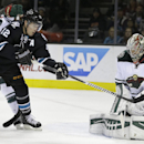 San Jose Sharks' Patrick Marleau (12) takes a shot against Minnesota Wild goalie Darcy Kuemper, right, during the first period of an NHL hockey game Thursday, Dec. 11, 2014, in San Jose, Calif The Associated Press