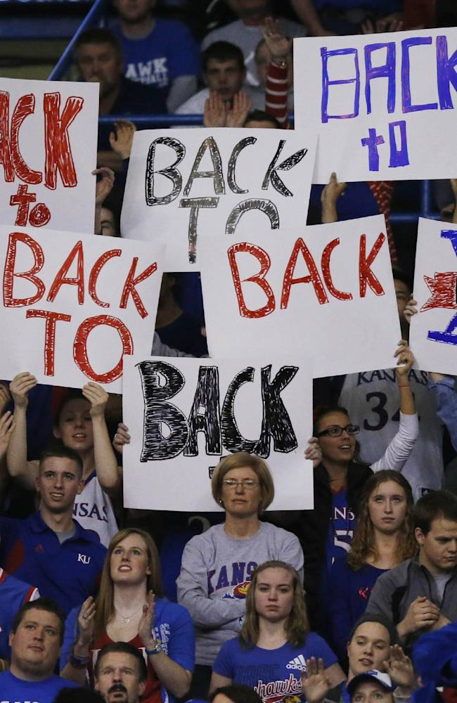 Kansas fans celebrate gaining a share of their tenth straight Big-12 championship during the second half of an NCAA college basketball game against Oklahoma in Lawrence, Kan., Monday, Feb. 24, 2014. Kansas defeated Oklahoma 83-75