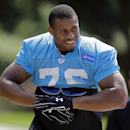Carolina Panthers' Greg Hardy smiles at fans as he arrives for an NFL football practice in Charlotte, N.C., Thursday, Sept. 11, 2014. Hardy has been convicted on two counts of domestic violence and is still playing. Though he has already been found guilty, the league is sticking by its policy to wait until the appeal process has been heard before making any decision on a possible suspension. (AP Photo/Chuck Burton)