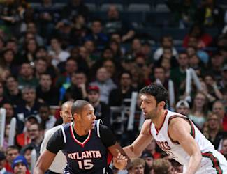 MILWAUKEE, WI - DECEMBER 27: Al Horford #15 of the Atlanta Hawks defends the ball against the Milwaukee Bucks during the game on December 27, 2014 at the BMO Harris Bradley Center in Milwaukee, Wisconsin. (Photo by Gary Dineen/NBAE via Getty Images)