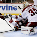 Arizona Coyotes goalie Louis Domingue, right, blocks a shot by Anaheim Ducks right wing Stefan Noesen during the second period of an NHL hockey preseason game in Anaheim, Calif., Tuesday, Sept. 23, 2014. The Associated Press