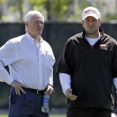 Cleveland Browns wide receivers coach Scott Turner, right, talks with owner Jimmy Haslam during an off-season practice at the NFL football team's practice facility in Berea, Ohio Thursday, May 16, 2013. (AP Photo/Mark Duncan)