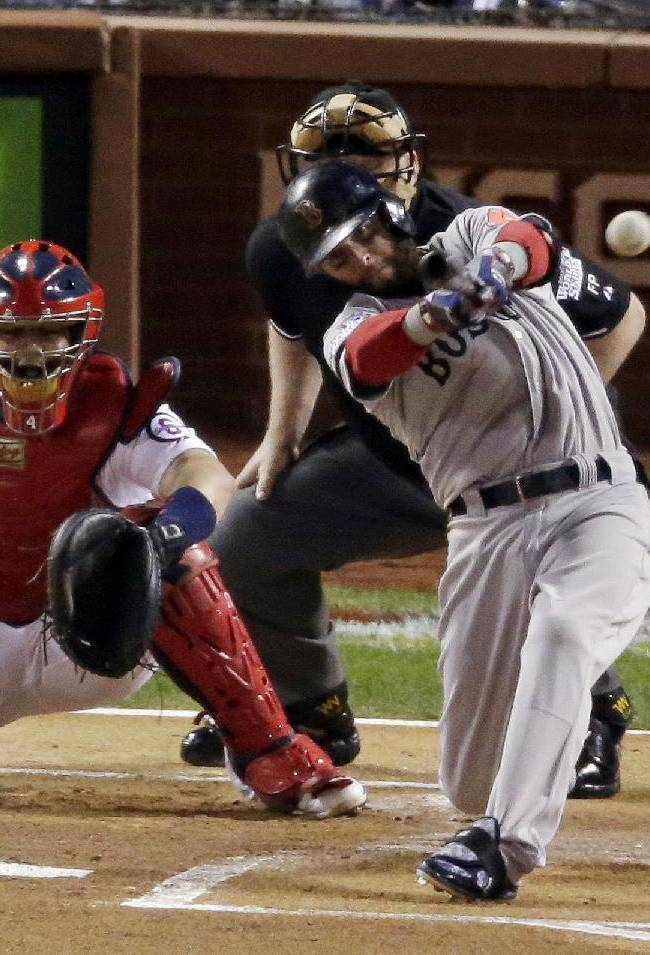 Boston Red Sox's Dustin Pedroia hits a double during the first inning of Game 5 of baseball's World Series against the St. Louis Cardinals Monday, Oct. 28, 2013, in St. Louis