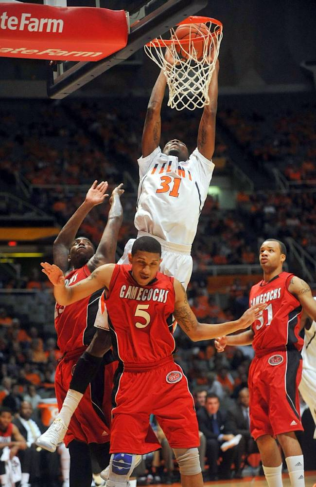 Illinois forward Austin Colbert (31) goes up for a dunk attempt over Jacksonville State guard Rico Sanders (5) during the first half of an NCAA college basketball game Sunday, Nov. 10, 2013, in Champaign, Ill