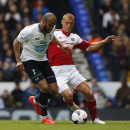 Tottenham Hotspur's Younes Kaboul, left, competes with Fulham's Steve Sidwell during their English Premier League soccer match at White Hart Lane, London, Saturday, April 19, 2014