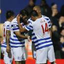 QPR's Charlie Austin, left, celebrates scoring a goal during the English Premier League soccer match between Queens Park Rangers and Manchester City at Loftus Road stadium in London, Saturday, Nov. 8, 2014