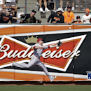 Arizona Diamondbacks left fielder Mark Trumbo misses a fly ball hit by San Francisco Giants left fielder Michael Morse during the fifth inning of the home opener MLB National League baseball game between the San Francisco Giants and the Arizona Diamondbac