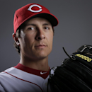 Cincinnati Reds pitcher Homer Bailey poses during the team photo day before spring training baseball workouts Thursday, Feb. 20, 2014, in Goodyear, Ariz. Bailey agreed to a $105 million, six-year contract on Wednesday that avoids arbitration and will help