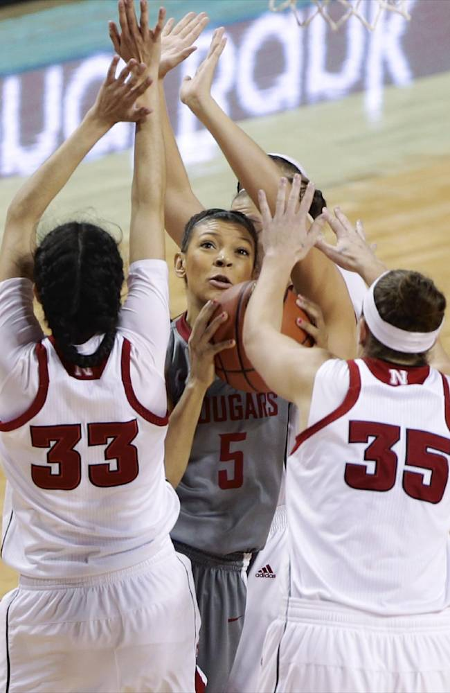 Washington State's Tia Presley (5) is surrounded by Nebraska's Rachel Theriot (33) and Jordan Hooper (35) in the first half of an NCAA college basketball game in Lincoln, Neb., Saturday, Nov. 30, 2013