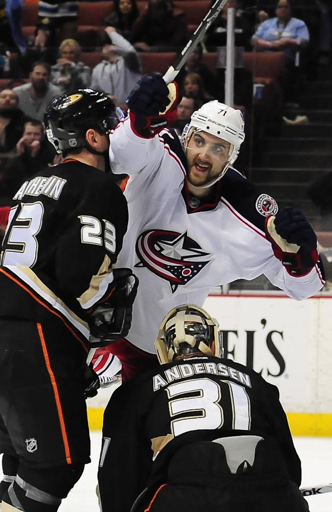 Columbus Blue Jackets left wing Nick Foligno, center, celebrates after scoring on Anaheim Ducks goalie Frederik Andersen (31) and defenseman Francois Beauchemin (23) during the third period of an NHL hockey game, Monday, Feb. 3, 2014, in Anaheim, Calif. The Blue Jackets won 4-2