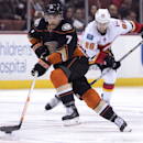 Anaheim Ducks' Andrew Cogliano, front, drives the puck against the Calgary Flames during an NHL hockey game Tuesday, Nov. 25, 2014, in Anaheim, Calif The Associated Press