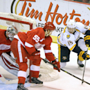 Nashville Predators center Craig Smith (15), right, takes a shot as Detroit Red Wings defenseman Niklas Kronwall (55), center, and goalie Petr Mrazek (34) block the net during the first period of an NHL hockey game in Detroit, Saturday, Jan. 17, 2015 The