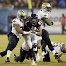 New Orleans Saints cornerback Keenan Lewis (28) tackles Chicago Bears running back Matt Forte (22) during the first half of an NFL football game Monday, Dec. 15, 2014, in Chicago The Associated Press