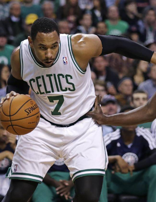 Boston Celtics forward Jared Sullinger (7) drives to the basket against Orlando Magic power forward Andrew Nicholson, right, during the first quarter of an NBA basketball game, in Boston, Monday, Nov. 11, 2013