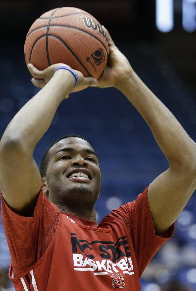 North Carolina State forward T.J. Warren shoots during practice for an NCAA college basketball tournament game, Monday, March 17, 2014, in Dayton, Ohio. NC State plays Xavier on Tuesday in a first round game