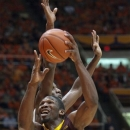 Minnesota Trevor Mbakwe, foreground, gets around Illinois' Nnanna Egwu during the second half of an NCAA men's college basketball game in Champaign, Ill., Wednesday, Jan. 9, 2013. (AP Photo/Robert K. O'Daniell)