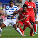 Queens Park Rangers' Leroy Fer, left, competes for the ball with Liverpool's Raheem Sterling during their English Premier League soccer match at Loftus Road, London, Sunday, Oct. 19, 2014