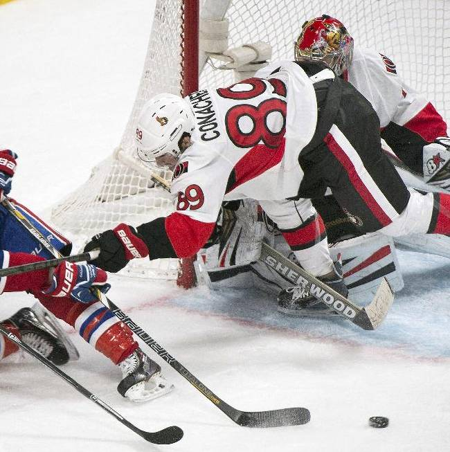 Ottawa Senators goaltender Craig Anderson, right, and Senators' Cory Conacher, center, defend as Montreal Canadiens' Brendan Gallagher moves in on the net during the second period of an NHL hockey game in Montreal, Saturday, Jan. 4, 2014