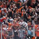The Ducks' Hampus Lindholm, left, celebrates Emerson Etem's second period goal against the Calgary Flames in Game 1 in the second round of the NHL Stanley Cup hockey playoffs, Thursday, April 30, 2015, in Anaheim, Calif. (Kevin Sullivan/The Orange County Register via AP) MAGS OUT; LOS ANGELES TIMES OUT; MANDATORY CREDIT