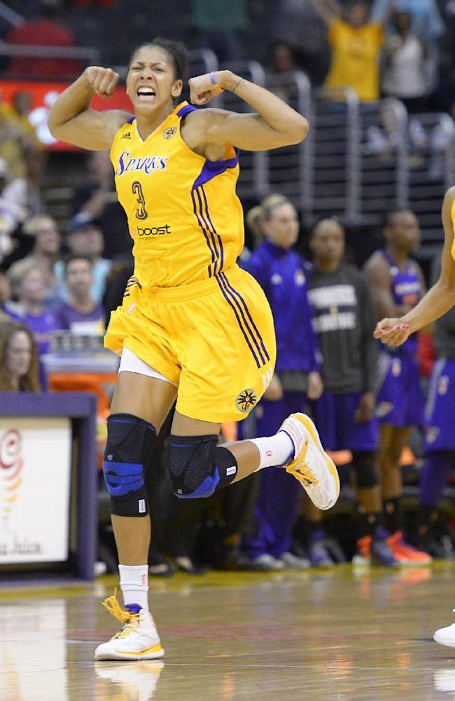 Los Angeles Sparks center Candace Parker, left, celebrates after scoring late in the game as guard Lindsey Harding looks on during the second half in Game 3 of a WNBA basketball Western Conference semifinal series against the Phoenix Mercury, Monday, Sept. 23, 2013, in  Los Angeles. The Mercury won 78-77