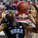 Duke's Elizabeth Williams (1) and North Carolina State's Markeisha Gatling reach for a rebound during the first half of an NCAA college basketball game in Raleigh, N.C., Thursday, Jan. 3, 2013. (AP Photo/Gerry Broome)