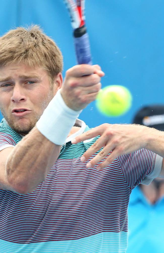 Ryan Harrison of the USA plays a shot in his match against Tatsuma Ito of Japan during the Brisbane International tennis tournament in Brisbane, Australia, Monday, Dec. 30, 2013