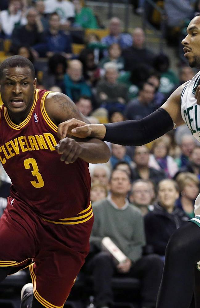 Cleveland Cavaliers' Dion Waiters (3) drives past Boston Celtics' Jared Sullinger (7) in the second quarter of an NBA basketball game in Boston, Saturday, Dec. 28, 2013