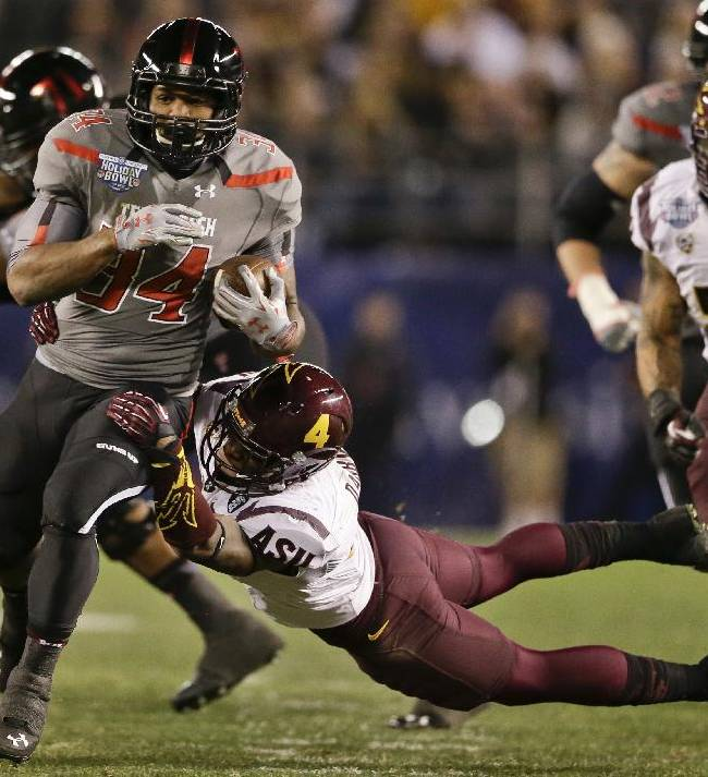 Texas Tech running back Kenny Williams, left, bust through the Arizona State defense for a 17 yard gain during the first half of the Holiday Bowl NCAA college football game, Monday, Dec. 30, 2013, in San Diego