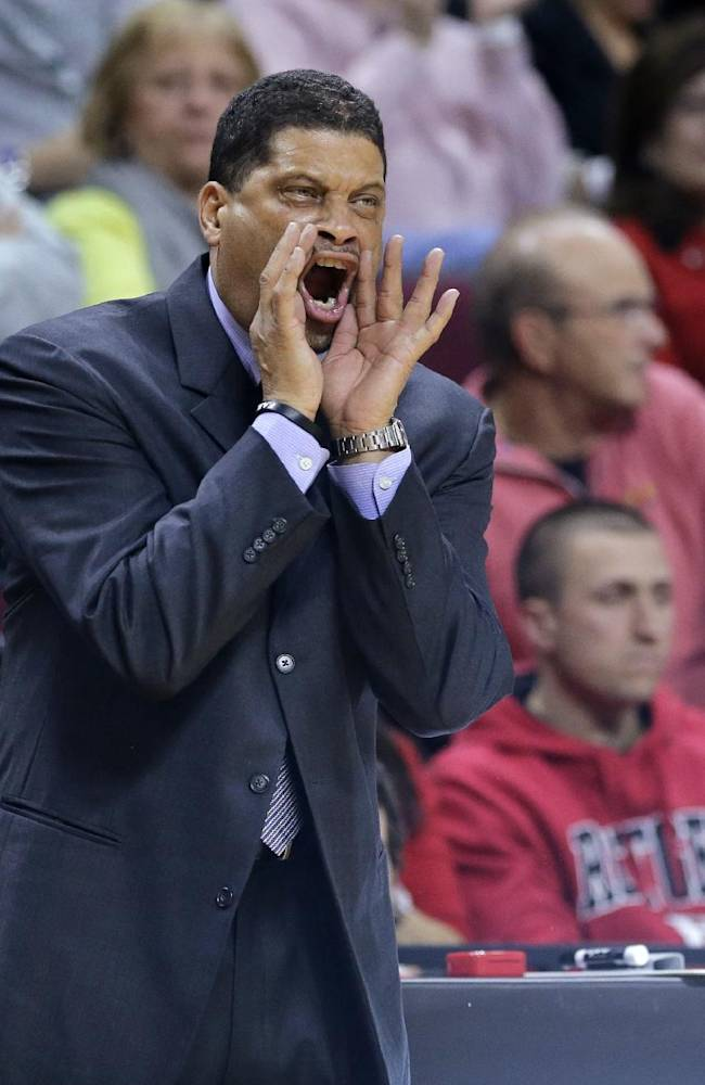 Rutgers coach Eddie Jordan shouts to his players during the first half of an NCAA college basketball game against Temple in Piscataway, N.J., Wednesday, Jan. 1, 2014. Rutgers won 71-66