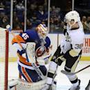 New York Islanders goalie Anders Nilsson (45) blocks a shot on goal by Pittsburgh Penguins' Zach Sill (38) in the first period of an NHL hockey game on Tuesday, Dec. 3, 2013, in Uniondale, N.Y. (AP Photo/Kathy Kmonicek)