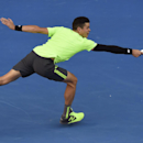 Milos Raonic of Canada stretches for a shot to Feliciano Lopez of Spain during their fourth round match at the Australian Open tennis championship in Melbourne, Australia, Monday, Jan. 26, 2015. (AP Photo/Andy Brownbill)