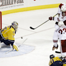 Arizona Coyotes left wing Martin Erat (10), of the Czech Republic, scores a goal against Nashville Predators goalie Pekka Rinne (35), of Finland, in the third period of an NHL hockey game Tuesday, Oct. 21, 2014, in Nashville, Tenn The Associated Press