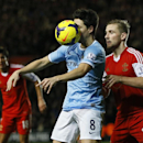 Southampton's Luke Shaw, right, vies for the ball with Manchester City's Samir Nasri during the English Premier League soccer match between Southampton and Manchester City at St Mary's Stadium in Southampton, England Saturday, Dec. 7, 2013