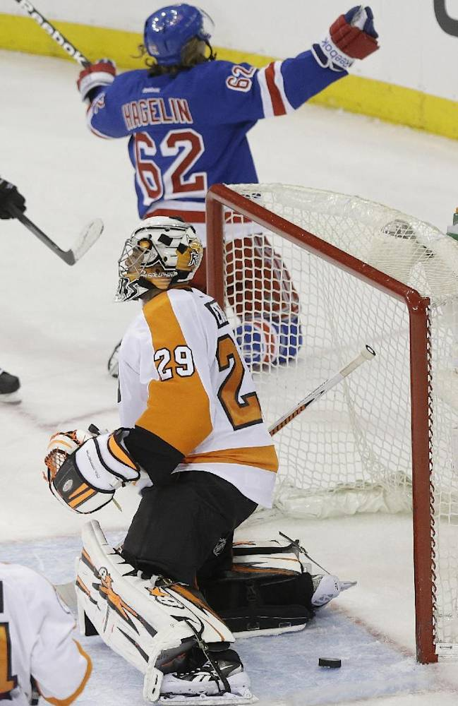 Philadelphia Flyers goalie Ray Emery (29) reacts as New York Rangers' Carl Hagelin (62) celebrates after scoring a goal during the third period in Game 1 of an NHL hockey first-round playoff series on Thursday, April 17, 2014, in New York. The Rangers won the game 4-1