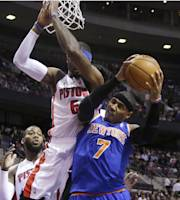 New York Knicks forward Carmelo Anthony (7) is blocked by Detroit Pistons forward Josh Smith (6) during the first half of an NBA basketball game in Auburn Hills, Mich., Tuesday, Nov. 19, 2013. (AP Photo/Carlos Osorio)