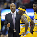 Denver Nuggets coach Brian Shaw, center, talks with forward Quincy Miller, left, guard Ty Lawson, center right, and forward Kenneth Faried during a timeout in the first half of an NBA basketball game against the New Orleans Pelicans on Wednesday, April 2,