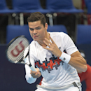 Canada's Milos Raonic  returns a ball to US tennis player  Steve Johnson during their first round match at the Swiss Indoors tennis tournament at the St. Jakobshalle in Basel, Switzerland, on Tuesday, Oct. 21, 2014. (AP Photo/Keystone,Georgios Kefalas)