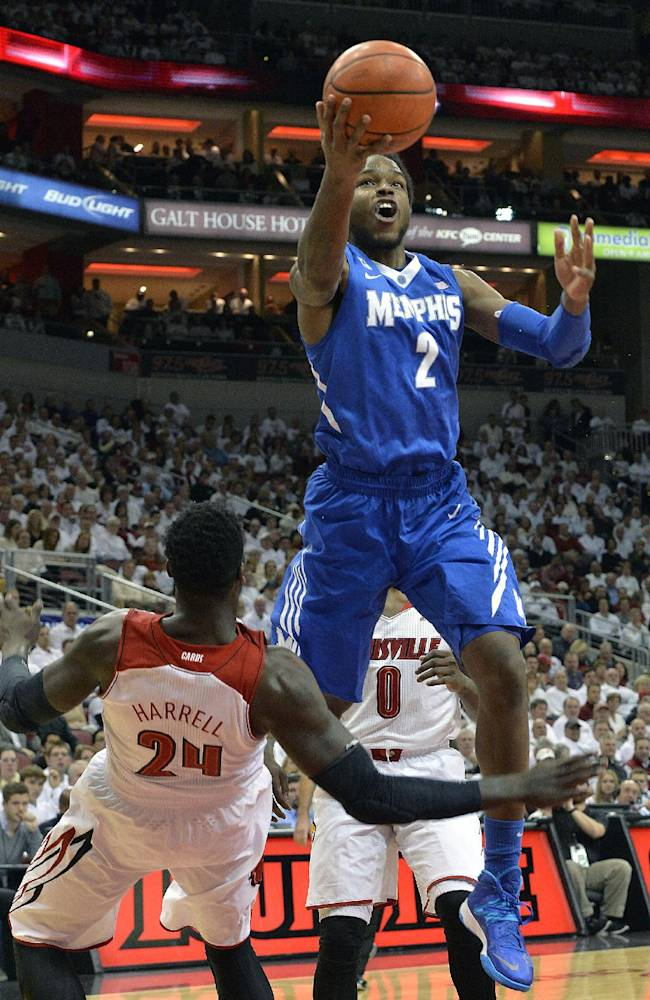 Memphis' Shaq Goodwin, right, shoots over the attempted block of Louisville's Montrezl Harrell during the first half of an NCAA college basketball game on Thursday Jan. 9, 2014, in Louisville, Ky