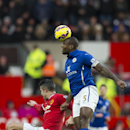 Leicester's captain Wes Morgan, right, heads the ball away from Manchester United's Robin van Persie during the English Premier League soccer match between Manchester United and Leicester at Old Trafford Stadium, Manchester, England, Saturday Jan. 31, 201