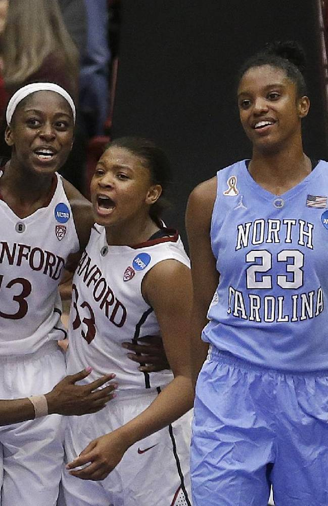 Stanford guard Lili Thompson, left, celebrates with forward Chiney Ogwumike (13) and guard Amber Orrange (33) next to North Carolina guard Diamond DeShields (23) and guard Danielle Butts (10) during the second half of a regional final at the NCAA women's college basketball tournament in Stanford, Calif., Tuesday, April 1, 2014. Stanford won 74-65