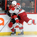 Ottawa Senators' Kyle Turris gets slammed into the boards by Carolina Hurricanes' Brad Malone during the first period on an NHL hockey game, Saturday, Jan. 17, 2015 in Ottawa, Ontario The Associated Press