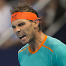 Spain's Rafael Nadal celebrates winning the first round match against Italy's Simone Bolelli in the Swiss Indoor tennis tournament at the St. Jakobshalle in Basel, Switzerland, Monday Oct. 20, 2014. (AP Photo/Keystone, Georgios Kefalas)