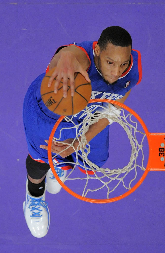 Philadelphia 76ers guard Michael Carter-Williams dunks during the second half of an NBA basketball game against the Los Angeles Lakers, Sunday, Dec. 29, 2013, in Los Angeles