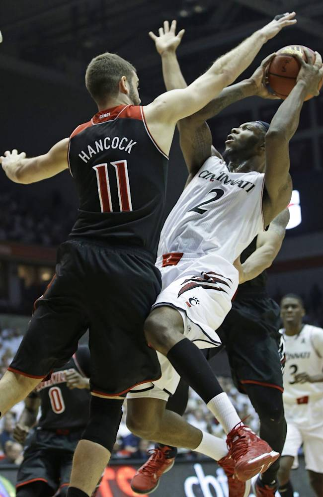 No. 11 Louisville beats No. 7 Cincinnati 58-57