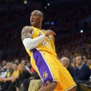 Los Angeles Lakers guard Kobe Bryant poses after hitting a shot and drawing a foul during the first half of the Lakers' NBA basketball game against the Dallas Mavericks, Tuesday, April 2, 2013, in Los Angeles. (AP Photo/Mark J. Terrill)