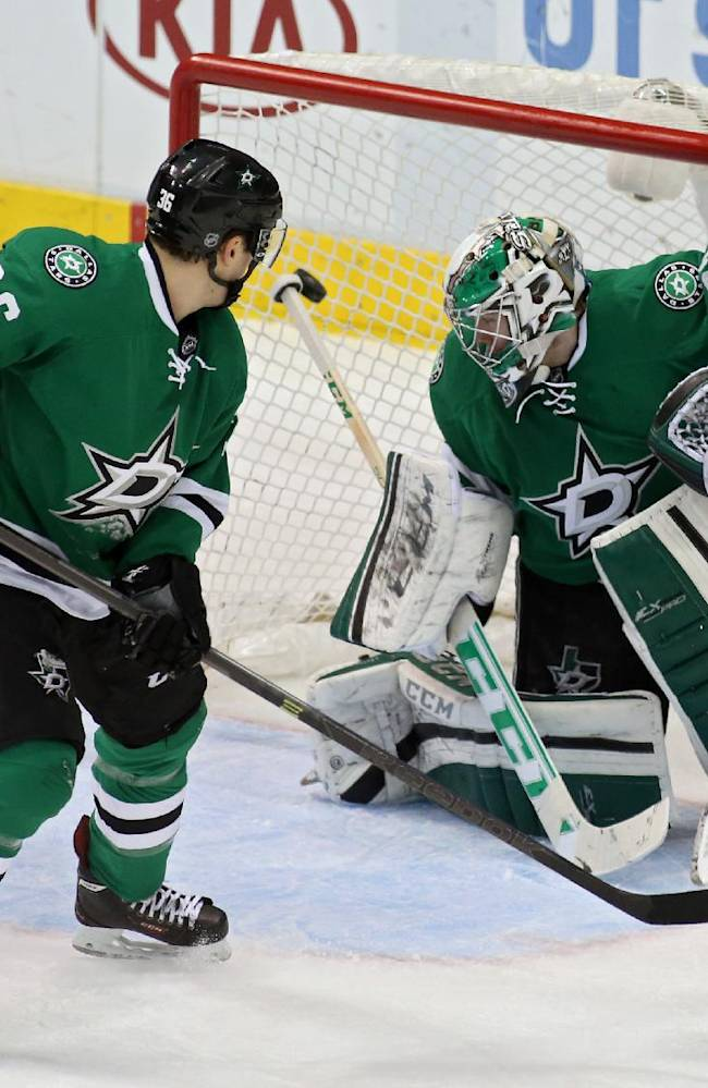 Montreal Canadiens left wing Travis Moen (32) scores on Dallas Stars goalie Kari Lehtonen (32), of Finalnd, as defenseman Cameron Gaunce (36) watches during the third period of an NHL hockey game Thursday, Jan. 2, 2014, in Dallas. Montreal won 6-4