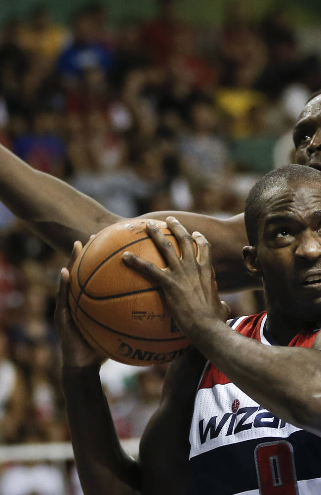 Washington Wizards' Martell Webster makes a move to the basket as he is guarded by Chicago Bulls' Luol Deng during the second half of an NBA preseason basketball game in Rio de Janeiro, Brazil, Saturday, Oct. 12, 2013